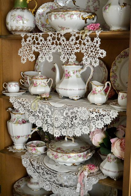 I love lace and pretty china...especially the lace on the top shelf that looks like snowflakes!