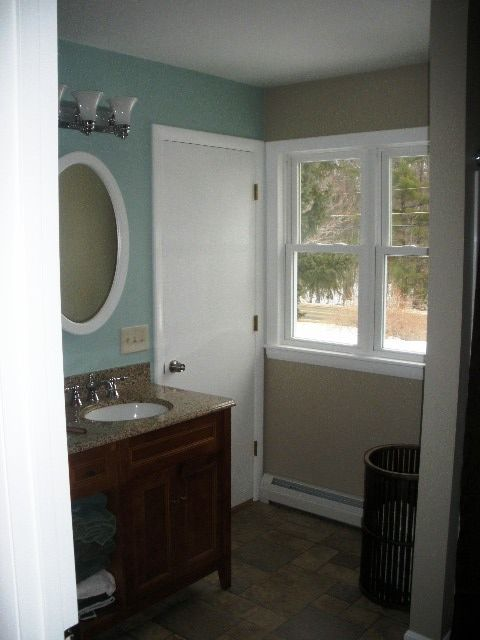 behr paint castle path with med brown vanity and similar color vanity top no to the blue wall and white trim