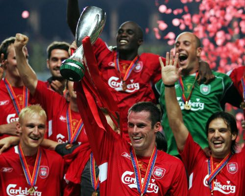 2005: He lifts the Super Cup as captain in Steven Gerrard's absence