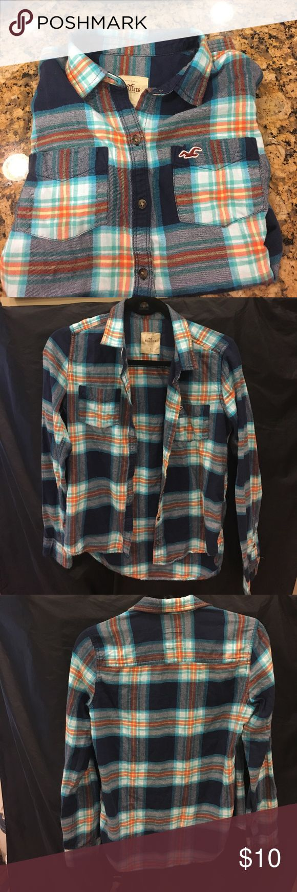 Hollister flannel Fall ready Hollister flannel! Size small has Navy blue aqua blue orange yellow green and white. Has all Original buttons. Breast pockets on both sides with embroidered Hollister logo Hollister Tops Button Down Shirts