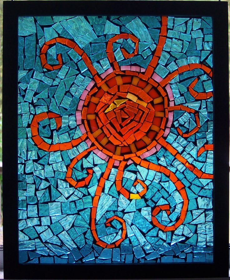 How to Make a Mosaic Stained Glass Window - Make a beautiful stained glass window with this easy mosaic method using a ready made frame. No Soldering!