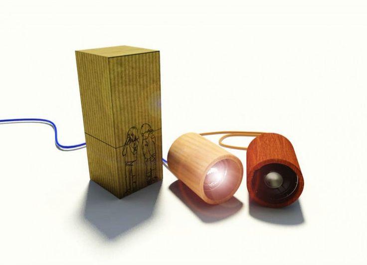 Formabilio - Il progetto prende spunto da un gioco che ognuno nella sua infanzia ha provato. I due cilindri di abete bianco e rosso contengono in realtà un impianto illuminante, che sfrutta la tecnologia led, e un impianto audio provvisto di aux in. I fili elettrici sono stati scelti di due colori accesi, blu elettrico ed arancione, per contrastare con il legno lasciato al naturale dei cilindri. Il packaging è di ridotte dimensioni ed ha un ingombro di cm 105 x 105 x 250.