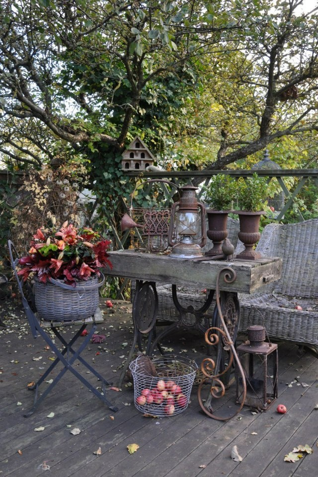 Rustic Style Patio with Antique containers and Table