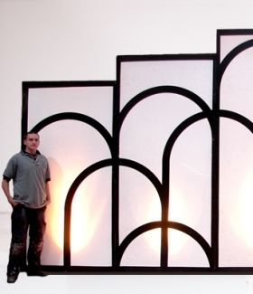 Art Deco Illuminated backdrop. I bet we could make one with cardboard and use it as the background for a Photo Booth. If you want the illumination we could tape glow sticks on the BACK