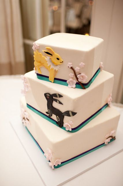 Umm yes.... lol. Jolteon and Umbreon wedding cake! But with all the evolutions. My daughters nicknamed after Eevee after all.