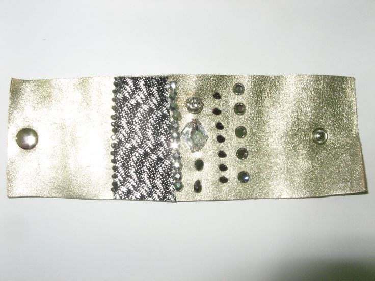 Leather cuff (1 pc)  Made with gold leather, black/silver leather, swarovski crystals and glass beads.