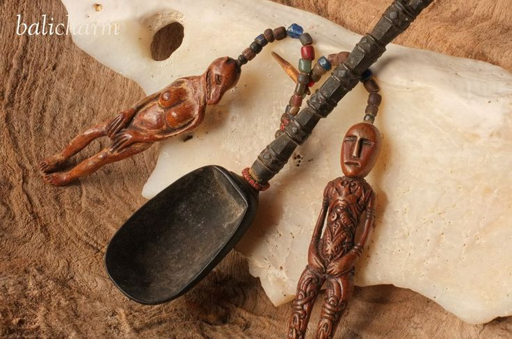 Traditional, antique mid-19th century wooden ladle from Indonesian Timor with contemporary amulets carved from ancient mammoth tusk