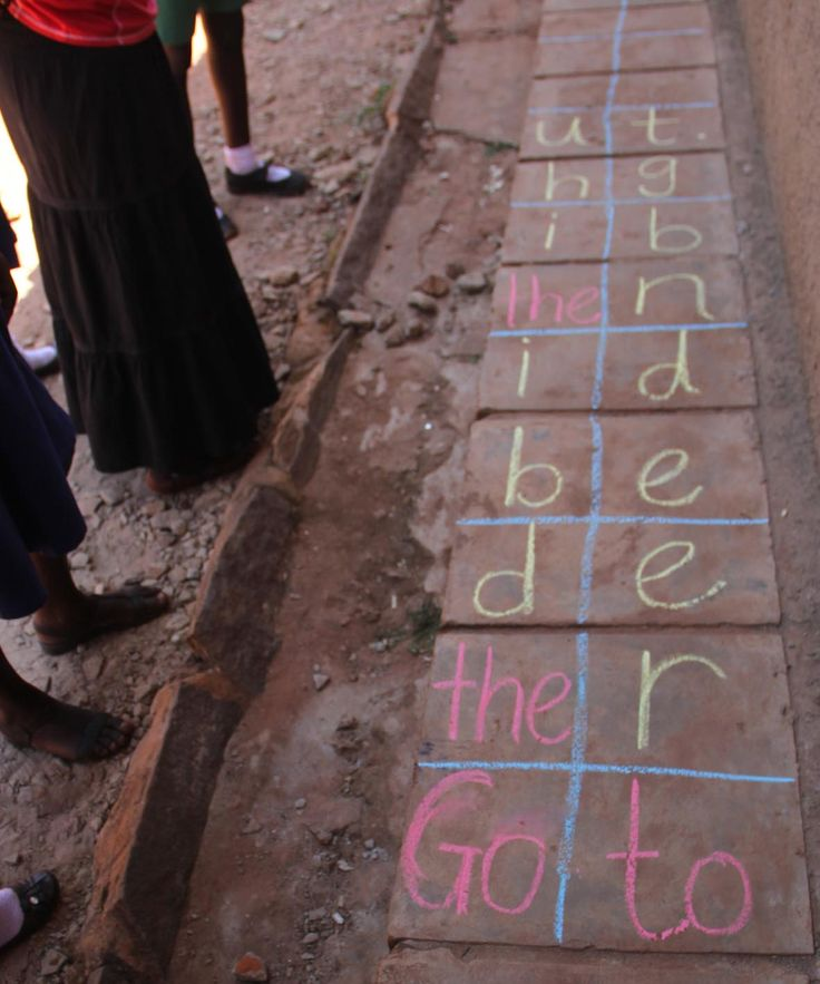 Here's a sentence written on the ground. The pupils need to read the sentence to get to the other side. Tricky words are written in on square; words for sounding are just written as single sounds and the child has to try and blend as they go. The sentence is: Go to the red bed in the big hut.
