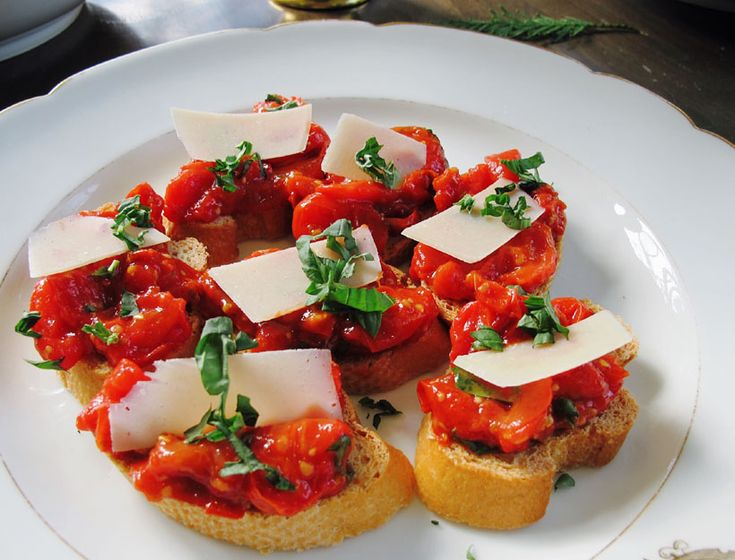 roasted tomato bruschetta. make the tomato mixture the day before, and the toasted bread a few hours in advance.