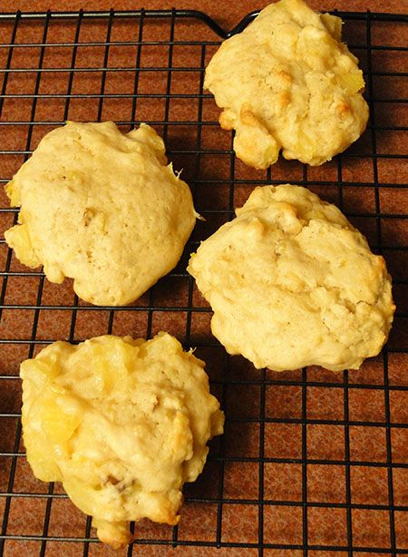Grandma Smith's famous pineapple cookie recipe. Chopped pecans or walnuts, soft buttery cookie dough, and sweet pineapple make these cookies so addictive.