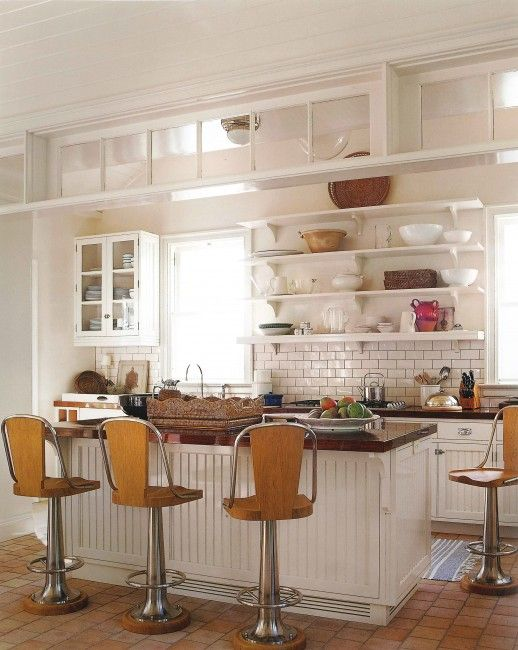 subway tile on the backsplash and off set squares on the floor. This is a beautiful kitchen, and i love those stools!