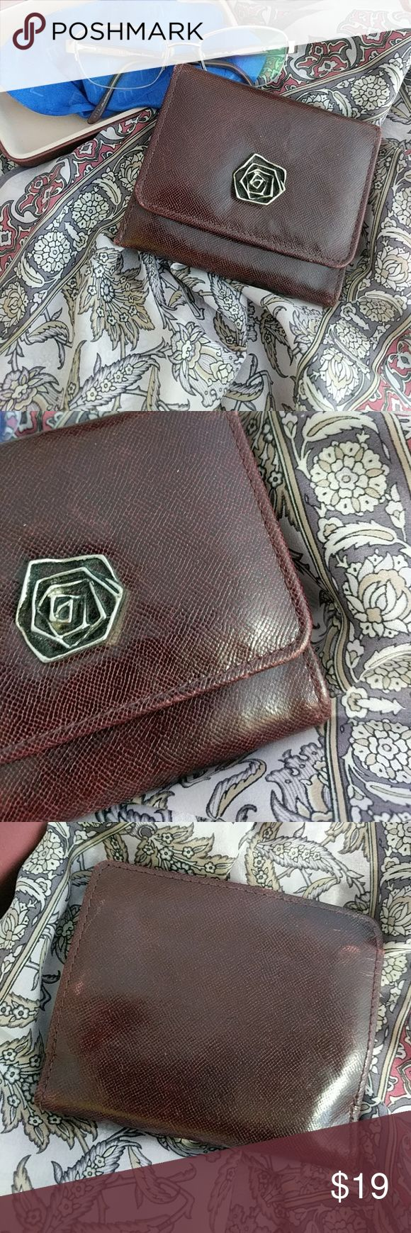 Vintage Rolf's cowhide wallet Gorgeous deep rich burgundy textured leather with Chanel-style floret.  The back has some wear giving a distressed appearance, adding to the timeless beauty of this piece.  Coin purse and billfold.  Space for 4 credit cards, and two picture ids, cash, and coin.  Made in China. Rolf's Bags Wallets