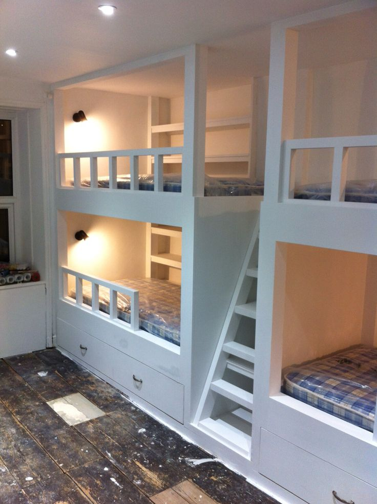 6 beds in one bunk www.jlchurchilljoinery.com Maximising bedroom space. 4 bunk beds with two trundle beds. Great for when the friends stay over. Private shelving by each bed and additional shelving behind the steps