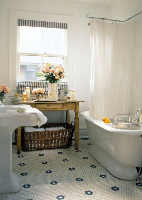 Better Homes and Gardens - Decorating Amazing vintage bathroom with frosted glass door panel, penny tiles floor, glossy white pedestal sink, brushed nickel faucet, vintage scale, gray walls paint color, subway tiles shower surround and vintage glass pendants.