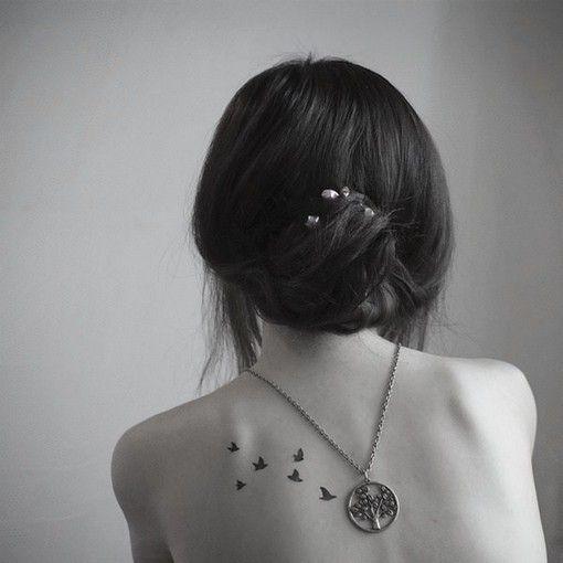 small bird tattoo on back