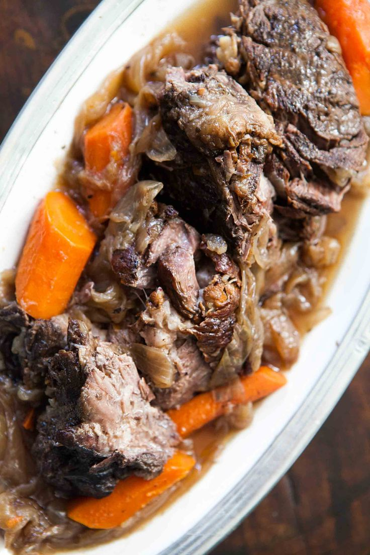 Best beef pot roast recipe! slow cooked on stove top or in oven with onion, garlic, carrots, and red wine.  Slow cooking on low heat practically ensures a tender pot roast from the tougher beef chuck or shoulder roast cut.