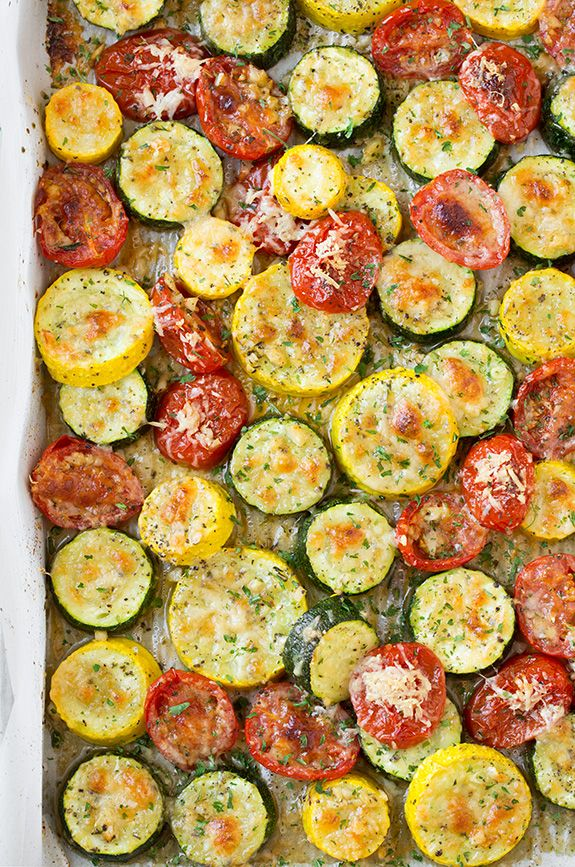 "Roasted Garlic-Parmesan Squash &Tomatoes ~ Whisk together 3 Tbsp olive oil, 4 cloves minced garlic & 1¼ tsp Italian seasoning. Place ½"" slices zucchini (2 small), yellow squash (2 small) & 14 oz halved grape tomatoes in large bowl. Pour oil mixture over & gently toss to evenly coat. Pour onto foiled lined 18""x13"" baking pan & spread into even layer. Season with salt & pepper, sprinkle with Parmesan. Roast at 400° ≈25 minutes until tender & Parmesan is golden brown. Garnish with parsley."