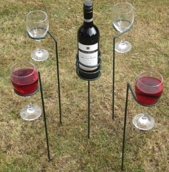 5 Piece outdoor wine sticks A set of 4 wine glass holders and a wine bottle holder to help you enjoy outdoor living on the lawn or your picnic. See how you could get a great camping gear for your camping needs @ www.coolcampinggearhq.com