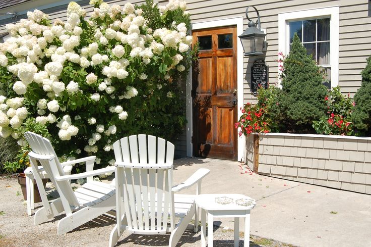 Who wouldn't want to relax with a cup of coffee on this patio, gazing into the brilliant white flower heads of that sensational hydrangea bush? A type of hydrangea that I, myself grow that has large white flower heads is 'Incrediball,' which I tell you about in this article: http://landscaping.about.com/od/shrubsbushes/p/Incrediball-hydrangea.htm