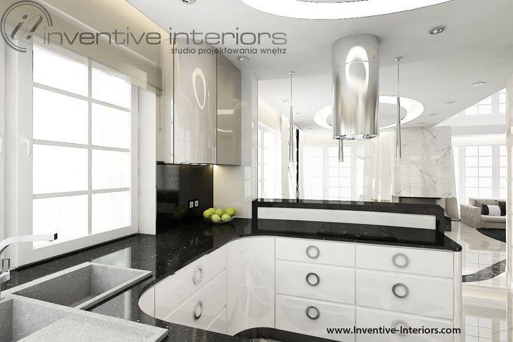 Projekt kuchni Inventive Interiors - luksusowa biała kuchnia z czarnym blatem - oryginalne uchwyty