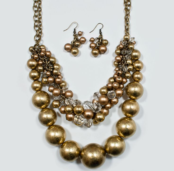 http://kareliafj.tictail.com/product/double-layered-vintage-metal-ball-w-crystal-necklace-earring-set