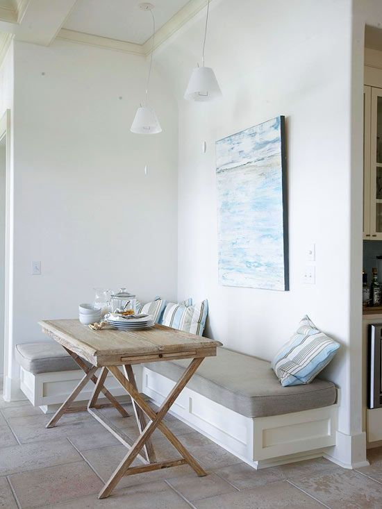 An empty wall off of this kitchen proved to be the perfect location for a casual breakfast nook. The L-shape bench stretches across the spare wall, transforming a potentially awkward space into something useful. The banquette faces a wall of French doors and boasts stunning views of the patio beyond, creating a relaxing early-morning retreat.