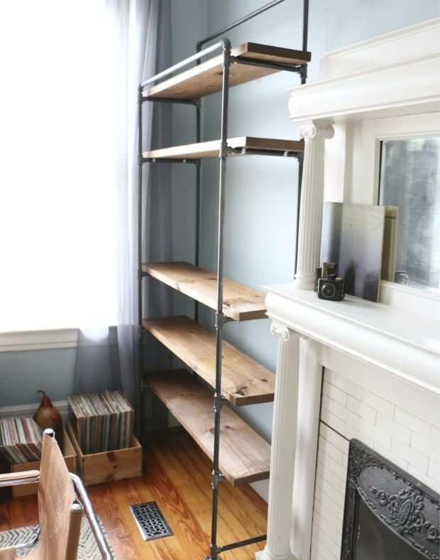 learn how to make your own industrial pipe bookcase. (Mostly pinning this because I love the combination of the industrial shelving and the elegant historic mantel.)