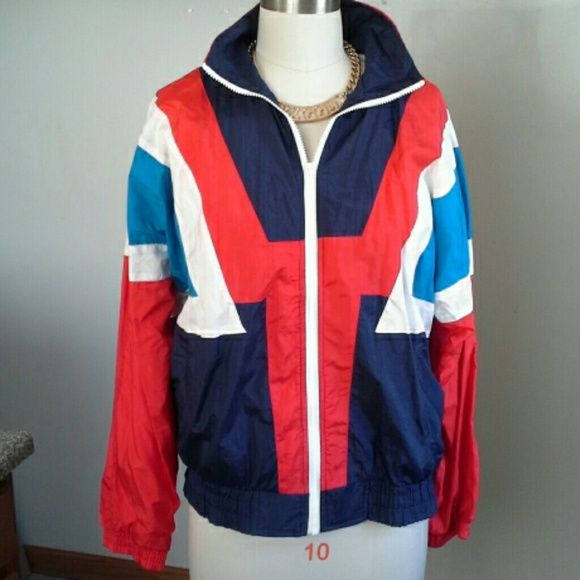 """80's Windbreaker Jacket Cool 100% nylon jacket lined with two front pockets. A plastic YKK zipper and elastic at waist and sleeves. It zips all the way up to the chin covering your neck for extra warmth. 25.5"""" armpit to armpit measurement and I 28"""" from top of neckline to hem. The only defect is that it is missing a topstitch on the left shoulder. Colin Jackets & Coats"""