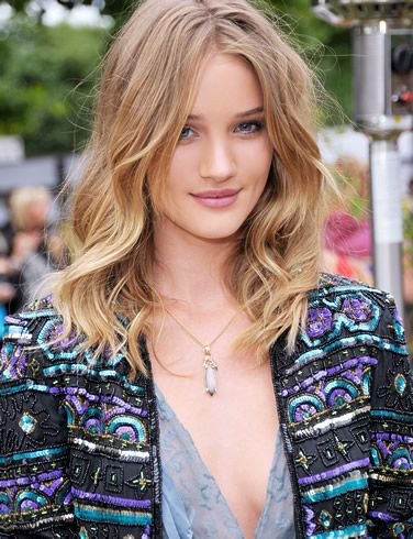 I like that facial expression as much as her fashion. Rosie Huntington-Whiteley
