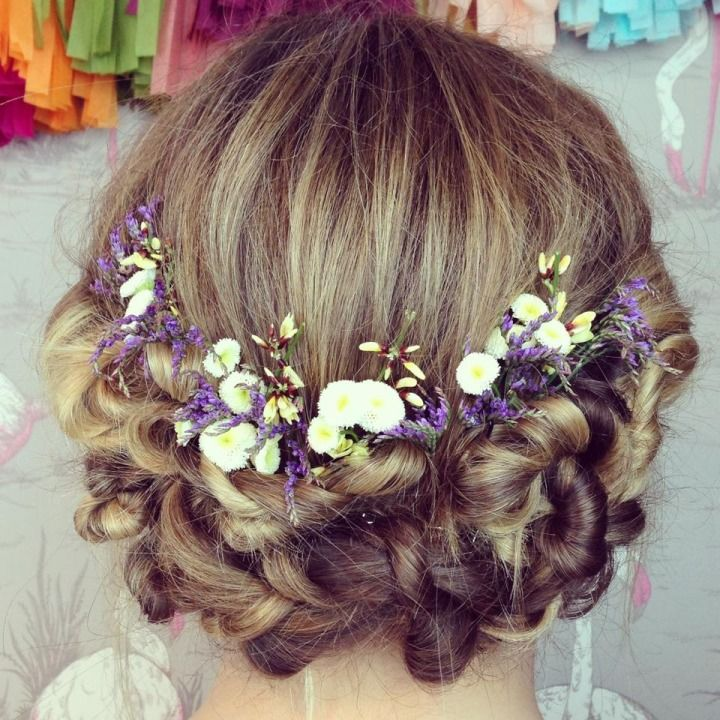 White, purple, and yellow wildflower bridal diadem. I think this wreath or half halo hairstyle would be amazing for bridesmaids or flower girls.. only with flowers that match or compliment their dresses as well as the central wedding colors