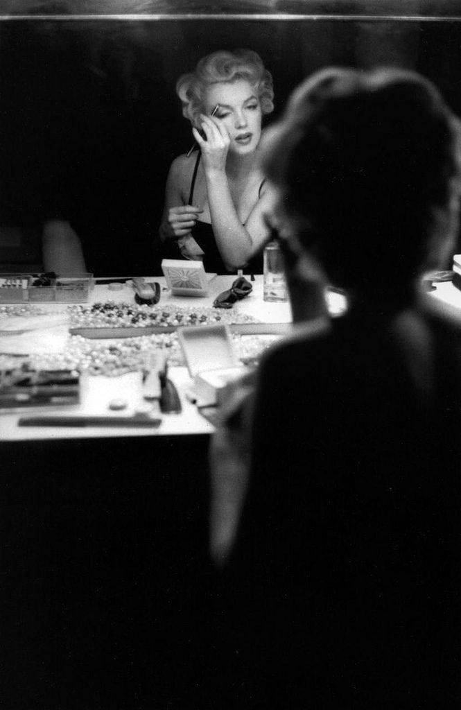 theniftyfifties:  Marilyn at the dressing table.