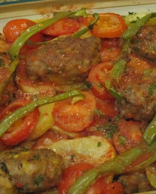 Turkish Food Izmir Köfte - casserole of meatballs, potatoes, tomatoes and peppers