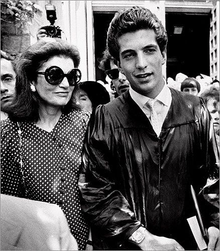 John Kennedy Jr walked with his mother, Jacqueline Kennedy Onassis, at Brown University in 1983 after receiving his Bachelor of Arts degree.