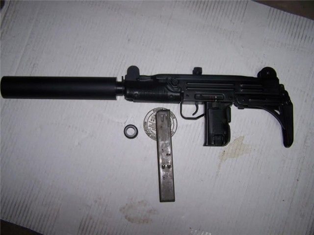 This IMI UZI with AWC Silencer has seen little use and is in great