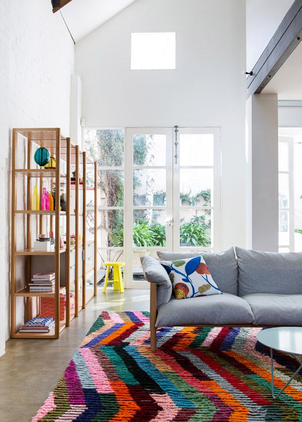 The rug, shelving and pops of color