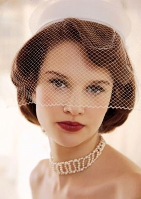 1950s style bride with pincurls, red lipstick and a pillbox hat