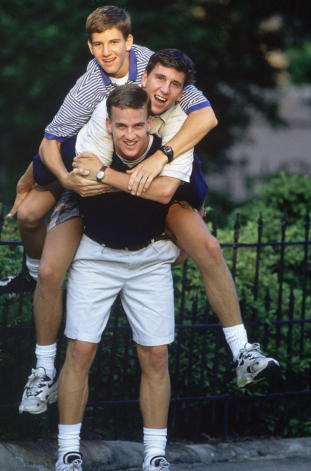 Peyton Manning carries his brothers Cooper and Eli on his back outside their home in New Orleans on July 11, 1996. The all-time NFL passing leader and two-time Super Bowl-winning quarterback, Peyton Manning is expected to announce his retirement from football on Monday, March 7, 2016. (Bill Frakes for SI)GALLERY: Rare Photos of Peyton Manning