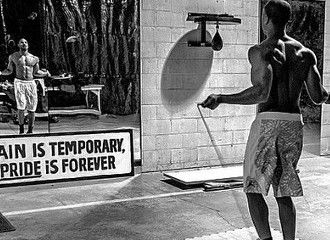 Michael B Jordan shares his story of transforming his body into shape for Creed (Rocky movie) Love the motivation sign in the mirror. Pain is temporary, Pride is forever! #FitnessRequired