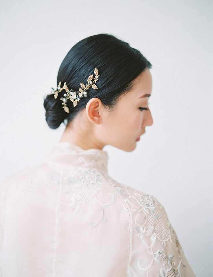 Set of 2 hairpieces hand-wired with crystal leaves, pearls, and flowers motifs. Designed in New York by Maggie Wu Studio