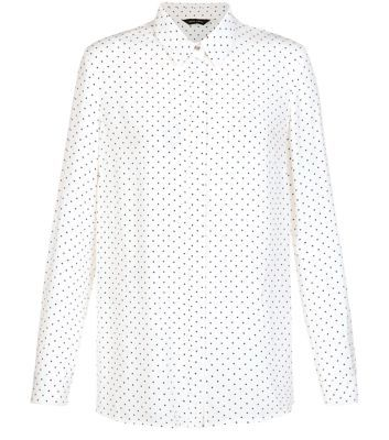 """From day to night this polka dot longline shirt is the perfect investment piece - try with a leather-look skirt and loafers to finish.- All over polka dot print- Collared neck- Concealed fastening- Simple long sleeves- Casual fit that is true to size- Longline design- Model is 5'8""""/176cm and wears UK 10/EU 38/US 6"""