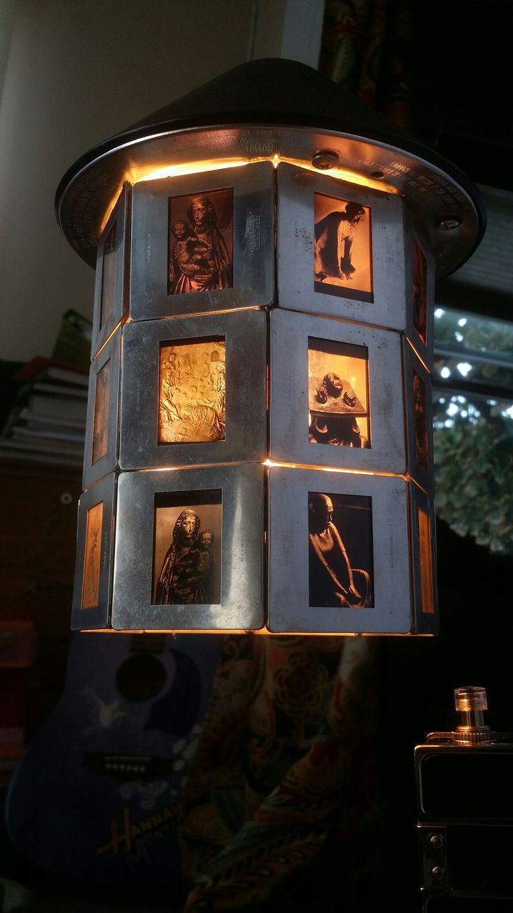 35mm slide prints with aluminum sleeve, soldered to make this lovely octagon lamp shade.