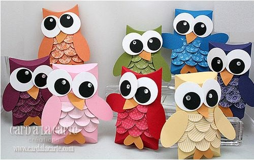 awwww  How to:  1. Fold top of a toilet paper role  2. cover toilet paper role with cardstock or construction paper  3. Decorate centre of owl with small pieces of feather resembling paper  4. Cut out 2 pieces of paper as wings and glue onto sides  5.Using orange paper, make a beak and feet  6. Glue 2 big eyeballs onto head of owl