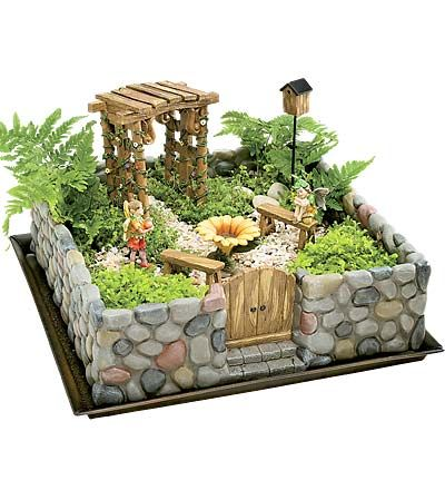 I want to have one of these, minus the fake fairy statues, tucked away in a beautiful little corner of the garden...