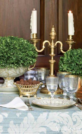 CAROLYNE ROEHM: Gold-rimmed drabware dessert service, c. 1850, by Wedgwood. French gilt basket, c. 1830. Nason & Moretti glasses. French 18th-c. candelabra. Damask tablecloth.