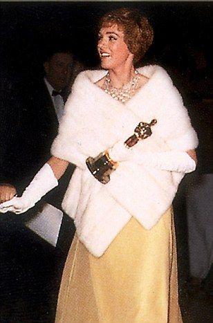 Brit Julie Andrews jazzed up her dress with a sparkling necklace and white fur stole...
