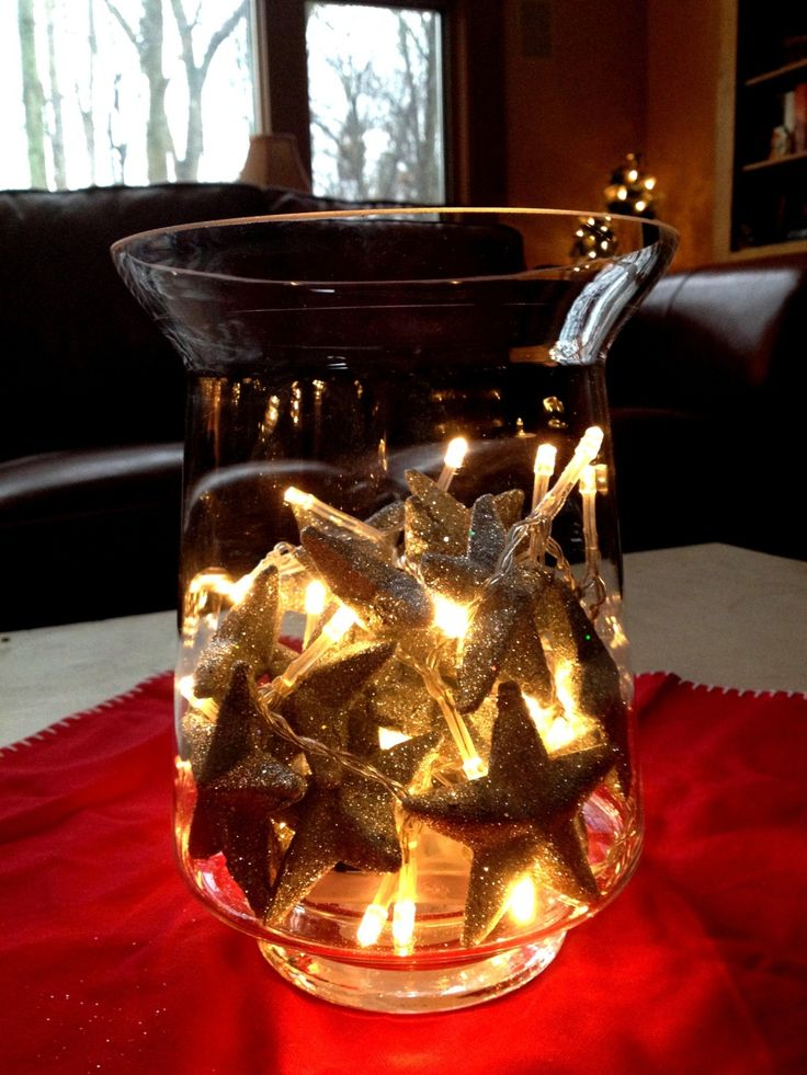 #DIY #Christmas #centerpiece - Put individual silver glittery stars in a medium-sized glass candle holder with a small, battery-powered string of white lights!