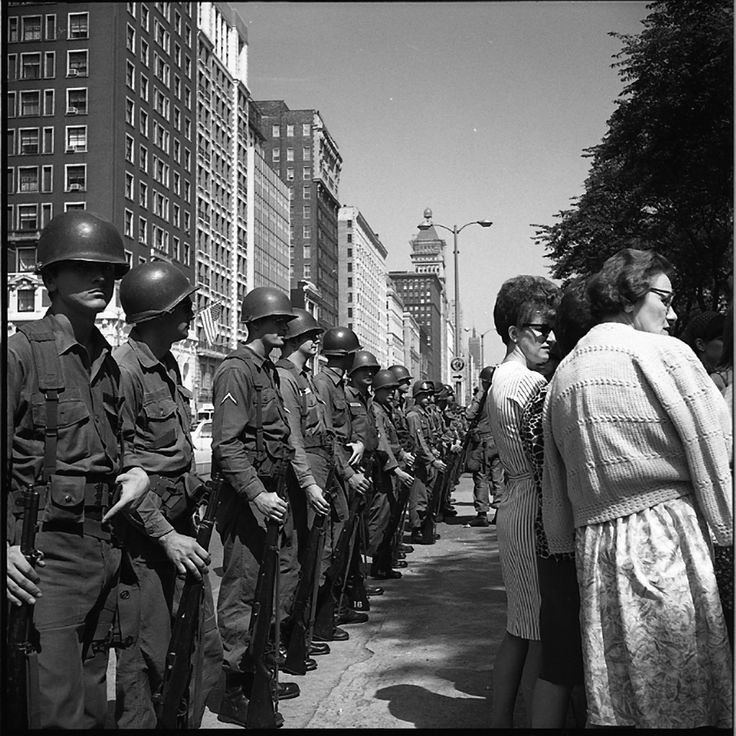by Vivian Maier : Military Line and Civilians, Chicago, 1968