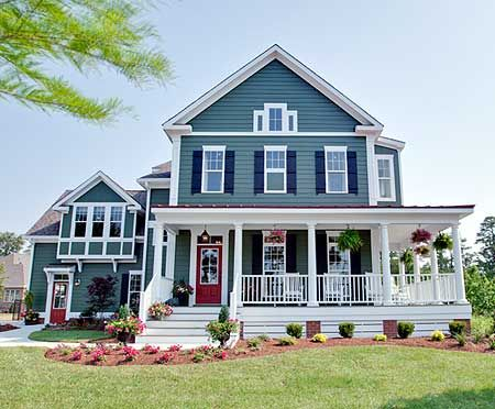 GAH! Old farm house on the outside, high vaulted ceilings, wrap around porch, garage, modern kitchen. Buy the complete plans for this home here.