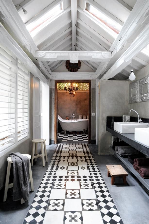 Love this bathroom! Bath in separate space, tiling down middle, long bench with shelf underneath, shutters...