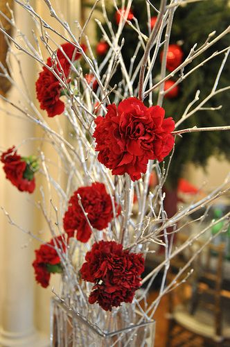Spray some twigs silver, put in a pretty vase, wire on some red carnations and done.